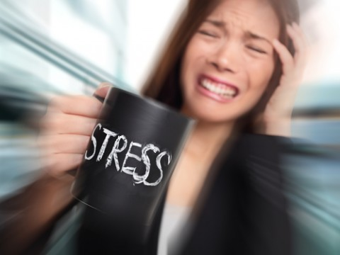 Womens-Health-and-Fertility_Woman-with-Stress-and-Headache