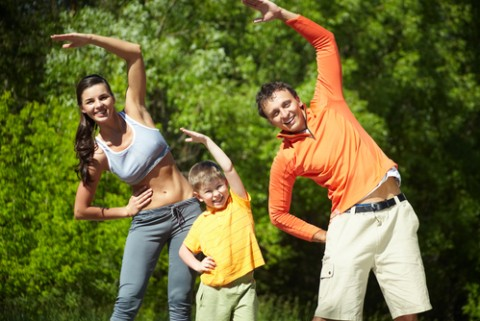 Infertility-Prevention_Family-Doing-Physical-Exercise-in-Park