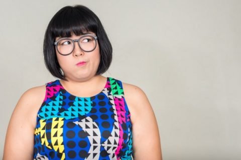 Portrait of overweight woman wondering about weight loss advice